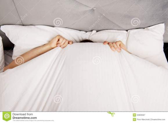 man-hiding-bed-under-sheets-funny-52826587